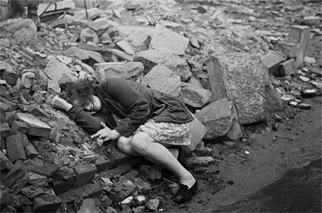 A German woman cries on the ruins of a building in Dresden, after the Allied bombings in World War II