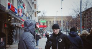 A Nordic Resistance Movement activist talks with a member of the public in Gothenburg