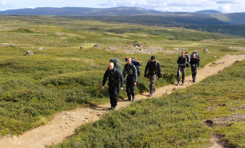 Nordic Resistance Movement members hiking in the mountains