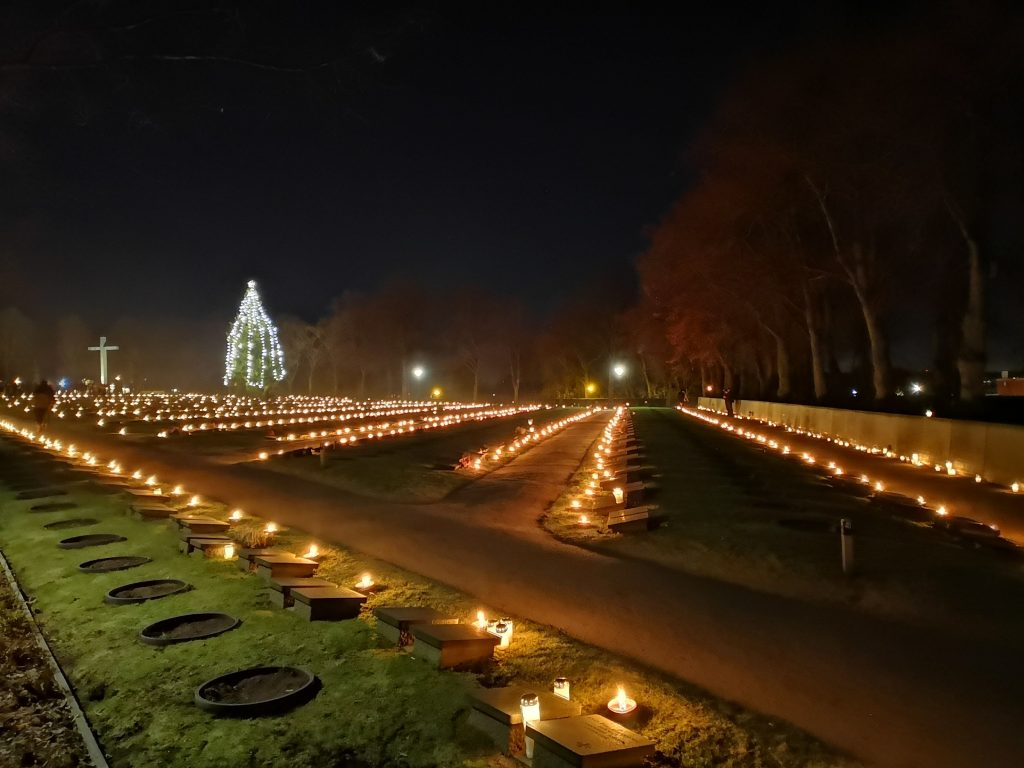 Hietaniemi cemetery in Helsinki on Independence Day 2018, lit up by candles