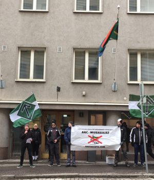 Nordic Resistance Movement activists protest against white genocide outside South African embassy in Helsinki, Finland