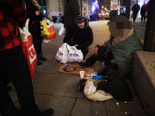 Nordic Resistance Movement activists give supplies to the homeless in Oslo