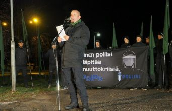 Simon Lindberg holds a speech at the 2018 Finnish Independence Day National Socialist march