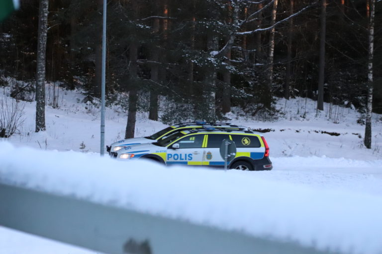 Police cars at a Nest 5 Nordic Resistance Movement banner activity in Borlänge, Sweden