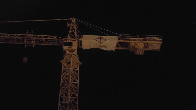 A Nordic Resistance Movement banner on a crane in Iceland