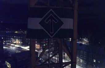 The Nordic Resistance Movement flag attached to a crane in Kärrtorp, Sweden