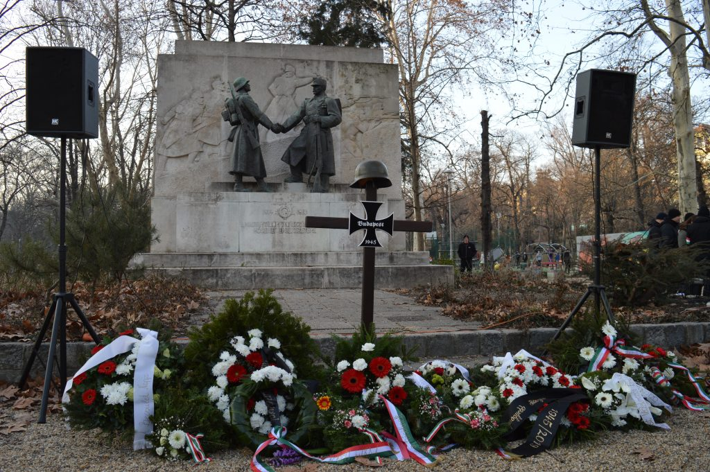 Wreaths laid at the foot of a WWII memorial in Budapest