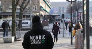 A Nordic Resistance Movement activist leaflets in Gothenburg