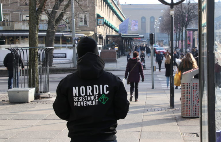 A Nordic Resistance Movement activist leaflets in Gothenburg