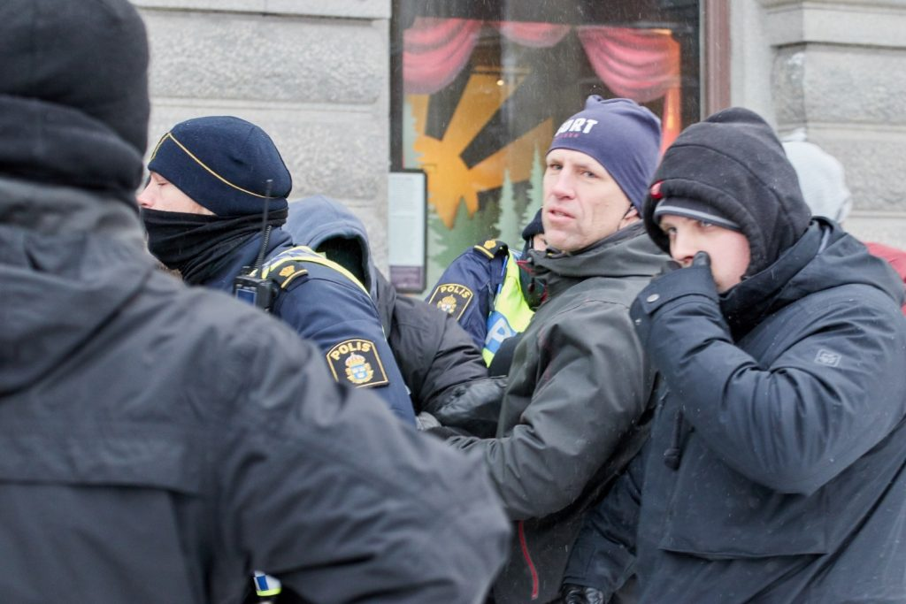 Undercover police arrest a young man for thought crime at a freedom of speech demonstration in Stockholm