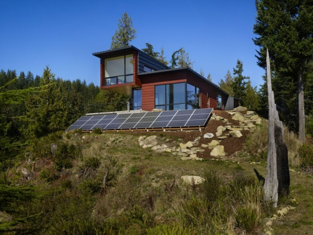 Eco-friendly house in the woods with solar panels