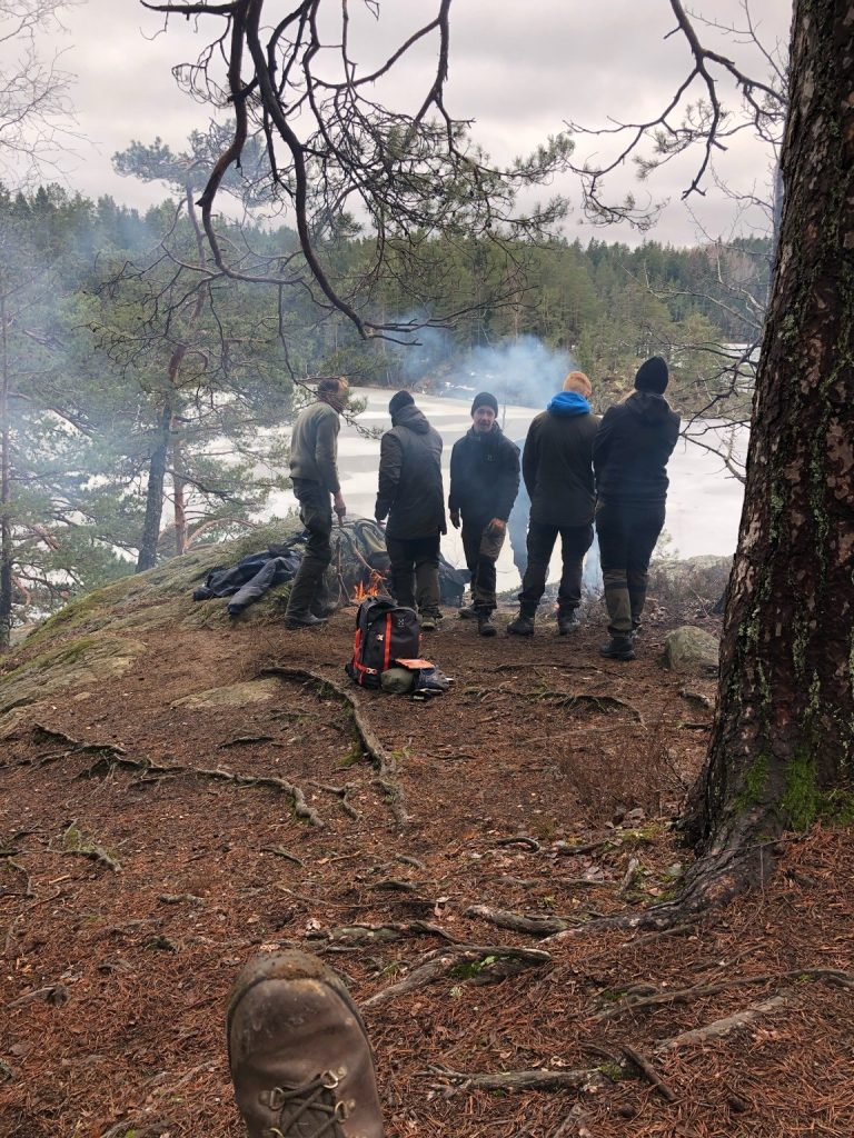 Nordic Resistance Movement members building a fire in the wilderness