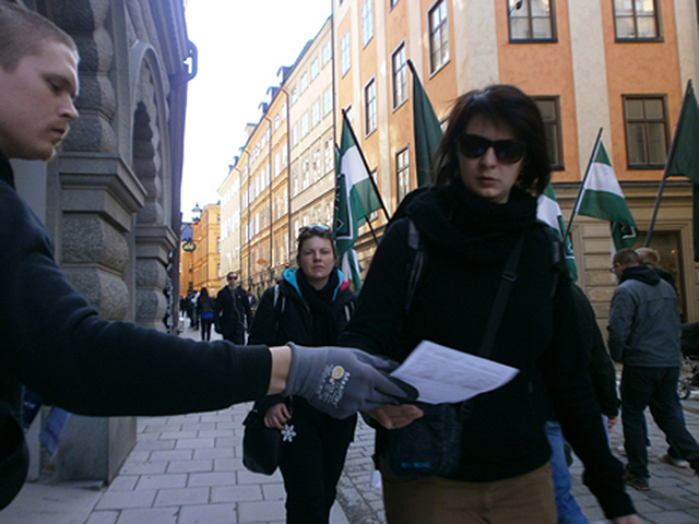 Nordic Resistance Movement activist hands out leaflets