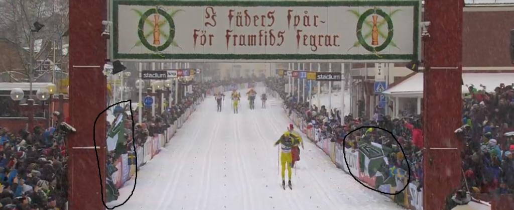 The Nordic Resistance Movement's Tyr Rune flags wave at the finishing line of the Vasaloppet cross-country ski race