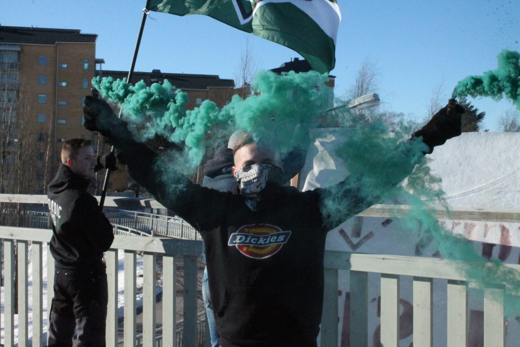 NRM banner activism with green smoke grenades