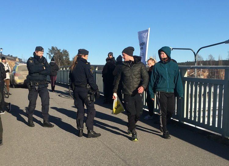 Police at NRM banner activism in Umeå