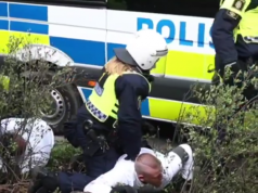Police van runs over Nordic Resistance Movement activist's foot during 1 May demonstration in Kungalv
