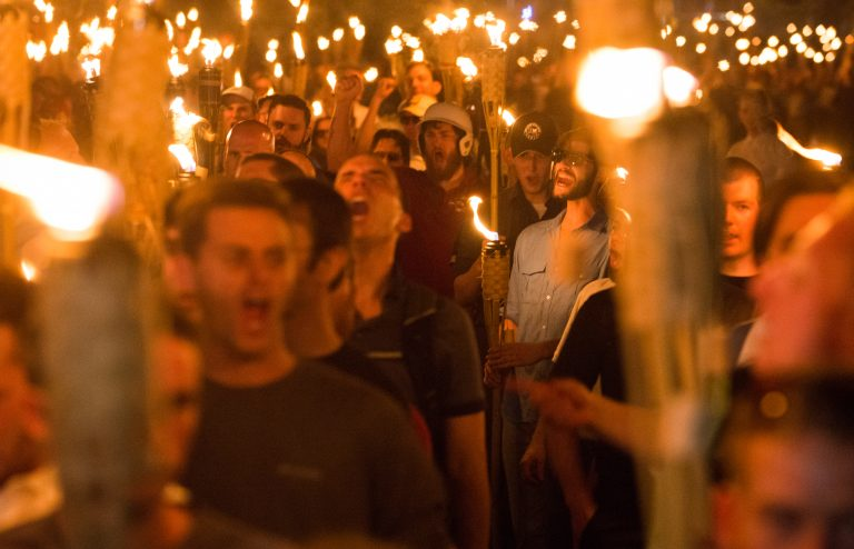 Protestors holding a torchlit march in Charlottesville