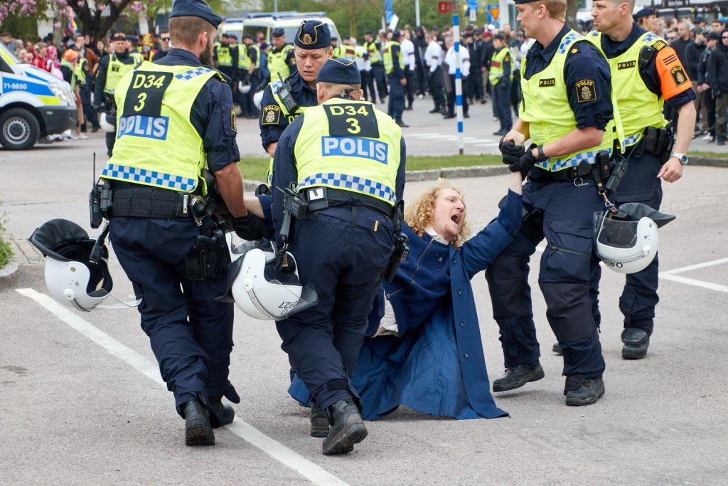 A counter-demonstrator is dragged away by police at the Nordic Resistance Movement 1 May demonstration in Kungalv