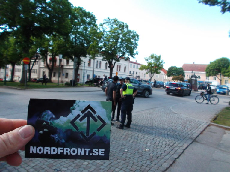 A racial stranger being arrested at a Nordic Resistance Movement activism session in Mariestad