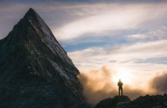 Man standing before a mountain