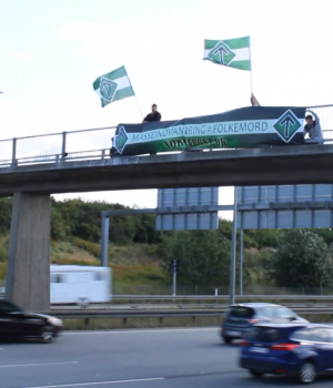 "Nordic Resistance Movement ""Mass Immigration = Genocide"" banner in Greve, Denmark"