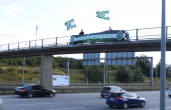 "Nordic Resistance Movement ""Mass Immigration = Genocide"" banner in Greve, Denmark"