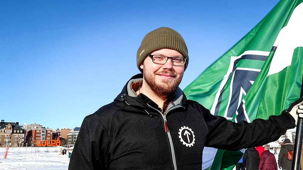 Nordic Resistance Movement activist on ice-covered harbour in Luleå