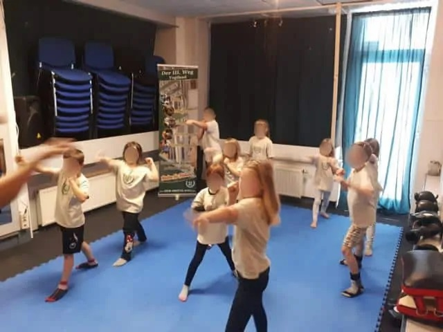 Children learning self-defence at Der Dritte Weg's office in Plauen