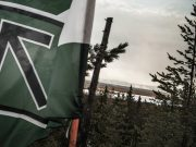 Nordic Resistance Movement flag in the forest