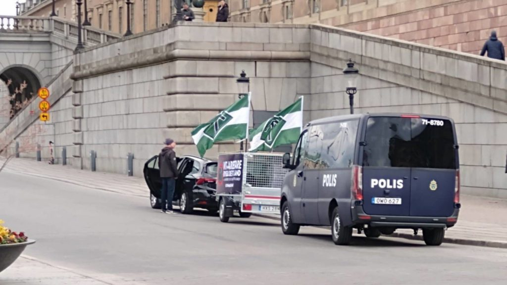 Police detaining NRM activists in Stockholm