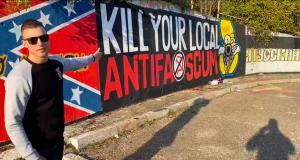 Rob Rundo with Antifa banner
