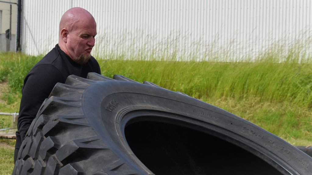 NRM member lifts large tyre during training session