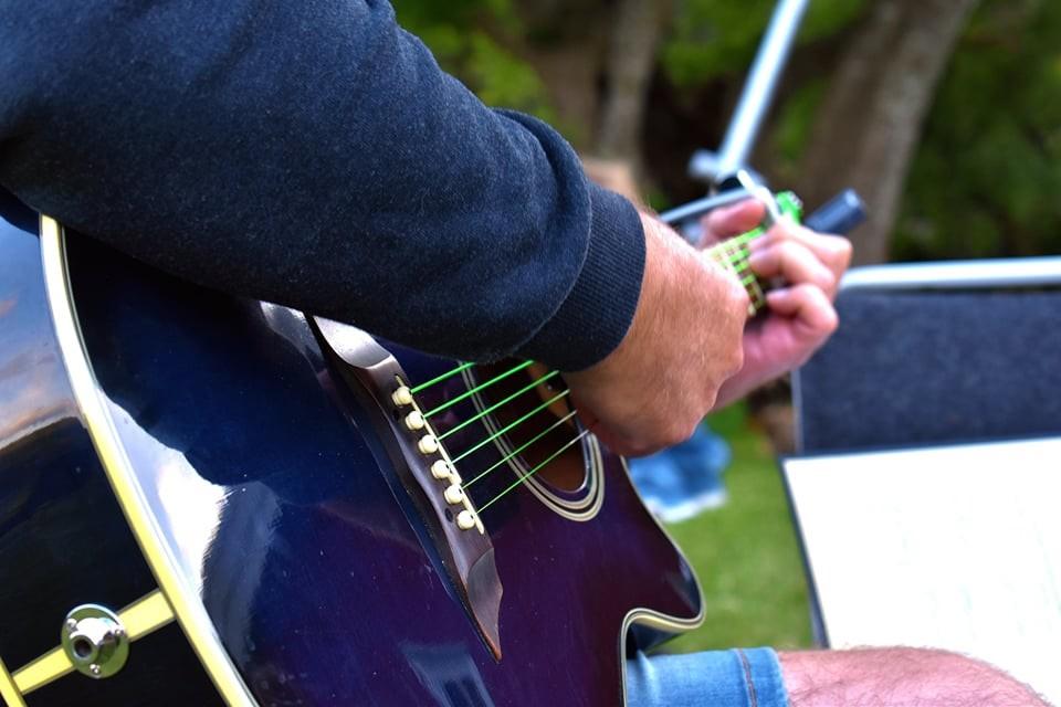 Guitar-playing at NRM Nest 2 Midsummer celebration
