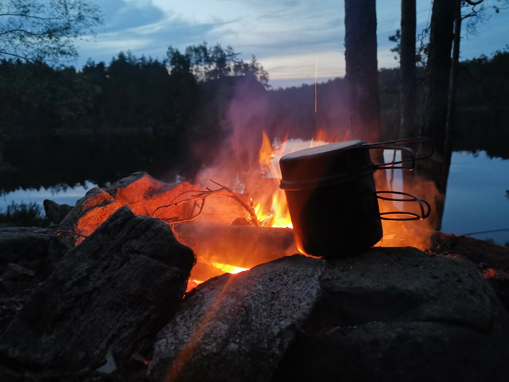 Wilderness camping and campfire in Norway