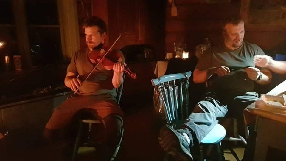 Musical performance in a cabin in the Jämtland woods, Sweden