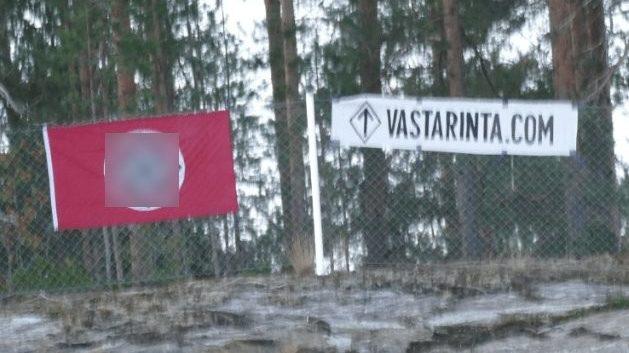 Swastika flag and Vastarinta banner, Finland